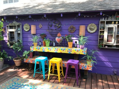 "The colorful buffet (alter?) on the riased deck ""El Jardin Encatador."""