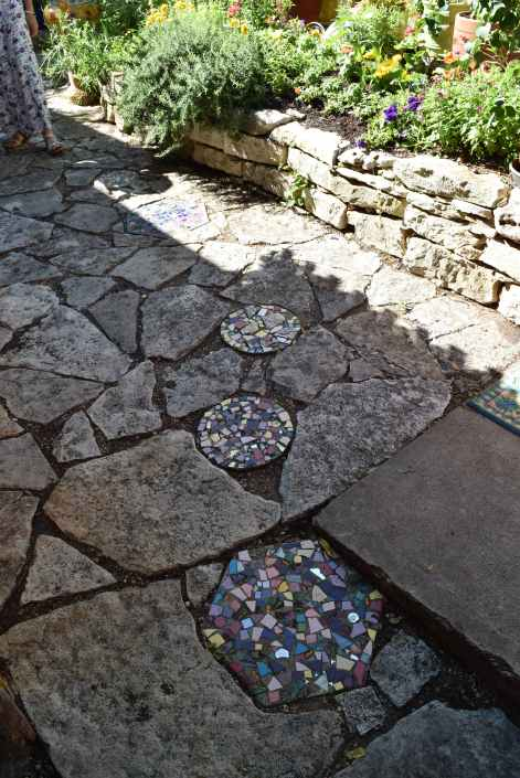 Look down. Tiled mosaics work their way in, spreading like weeds.n