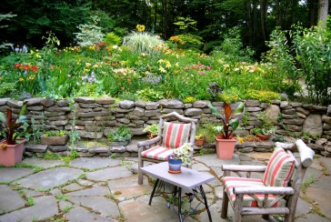 Smugcreek Garden in Hamburg, NY has seating all around the garden. It's a big garden and I bet every seat gets used.