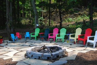 Plastic Adirondack chairs do have their place. This would not be as interesting without the colorful chairs. ((Lockport, NY)