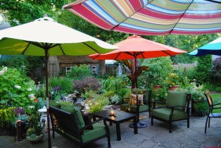 Typical outdoor furniture brought to new heights with a collection of colorful umbrellas. (Hamburg, NY)