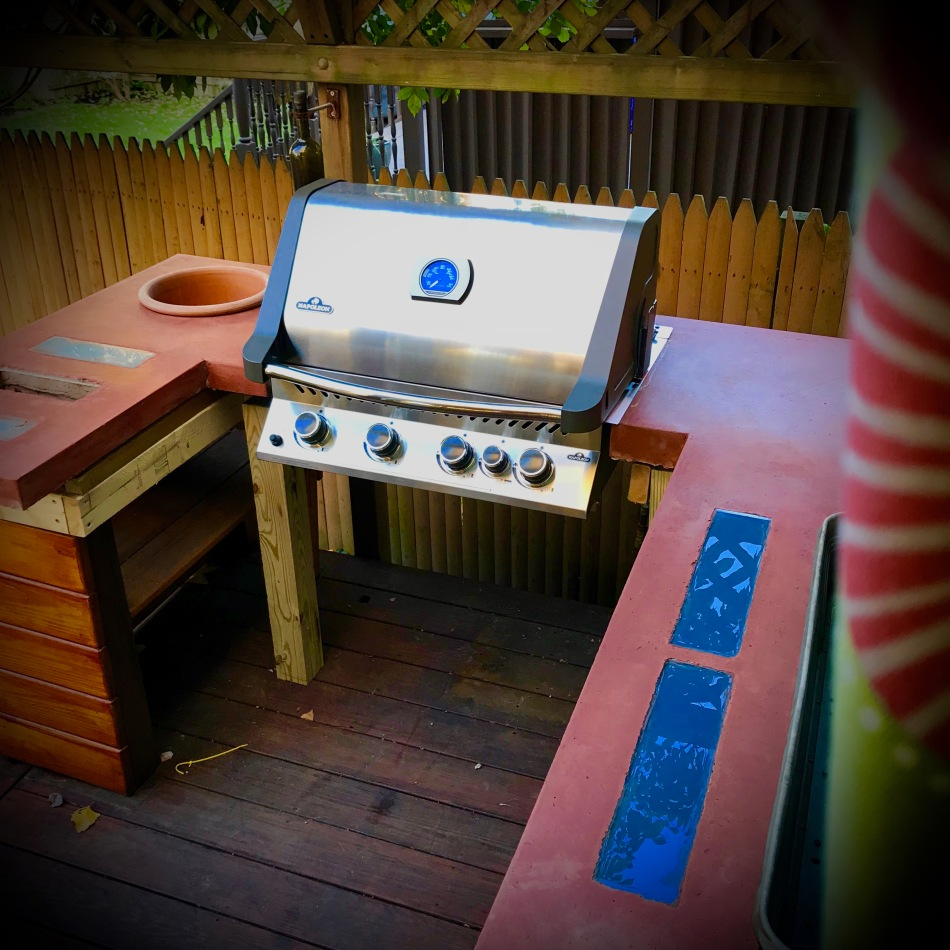 outdoor concrete coutnertpos construction placed with built-in grill