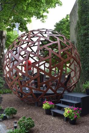 This geodesic dome is a pergola with seating for four or more. (Buffalo)