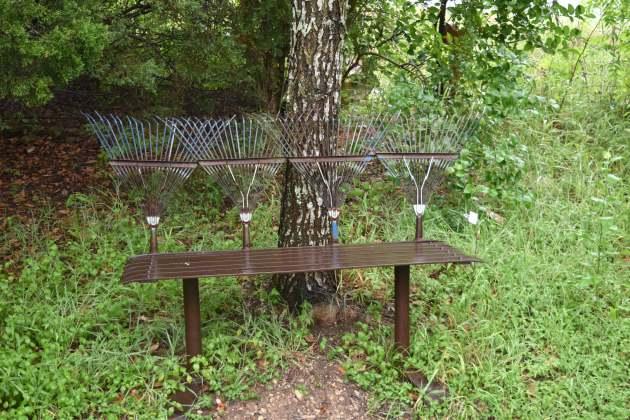 Rake-backed bench in Austin, TX.