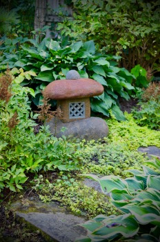 Handsome colors and natural materials make it look like the garden was built around this mock lantern.
