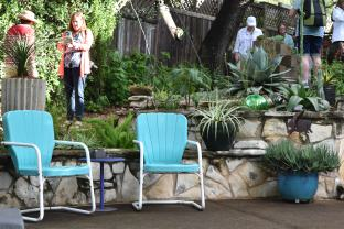 Mid-Century vintage chairs at home in an Austin garden.