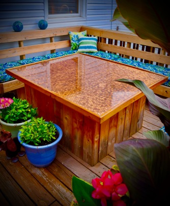 An L-shaped bench with a penny-tiled table in Cheektowaga, NY.