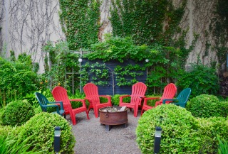 Plastic Adirondacks make great design statements in this Buffalo garden (the same garden as the Geodesic dome!)..