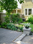 Change in eleveations and materials helps create garden rooms.