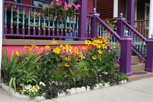Flowers are only a part of what makes this front yard garden colorful.