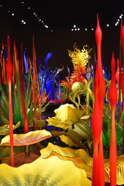 "Chihul's ""Glass Forest"" inspired by his mother's garden in an indoor gallery space."