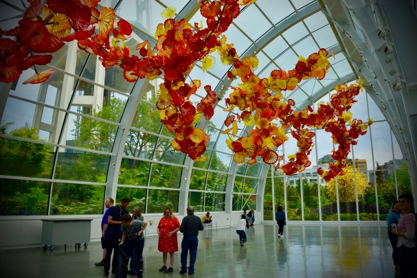 The suspended sculpture in the glass house is 100-feet long and has 1,340 individual pieces.