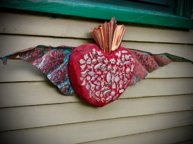I made this Mexican folk art corazón from scrap wood and copper and milagros (charms) purchased in Mexico a few years ago.