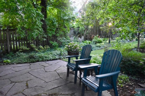 A sitting area in the back of the yard feels more like an Adirondack forest than a back yard in downtown Buffalo.