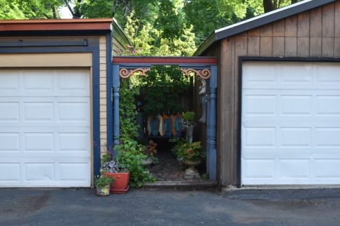 It's really just a small area between two garages - normally reserved for old tires, wheelbarrows and construction odds and ends.