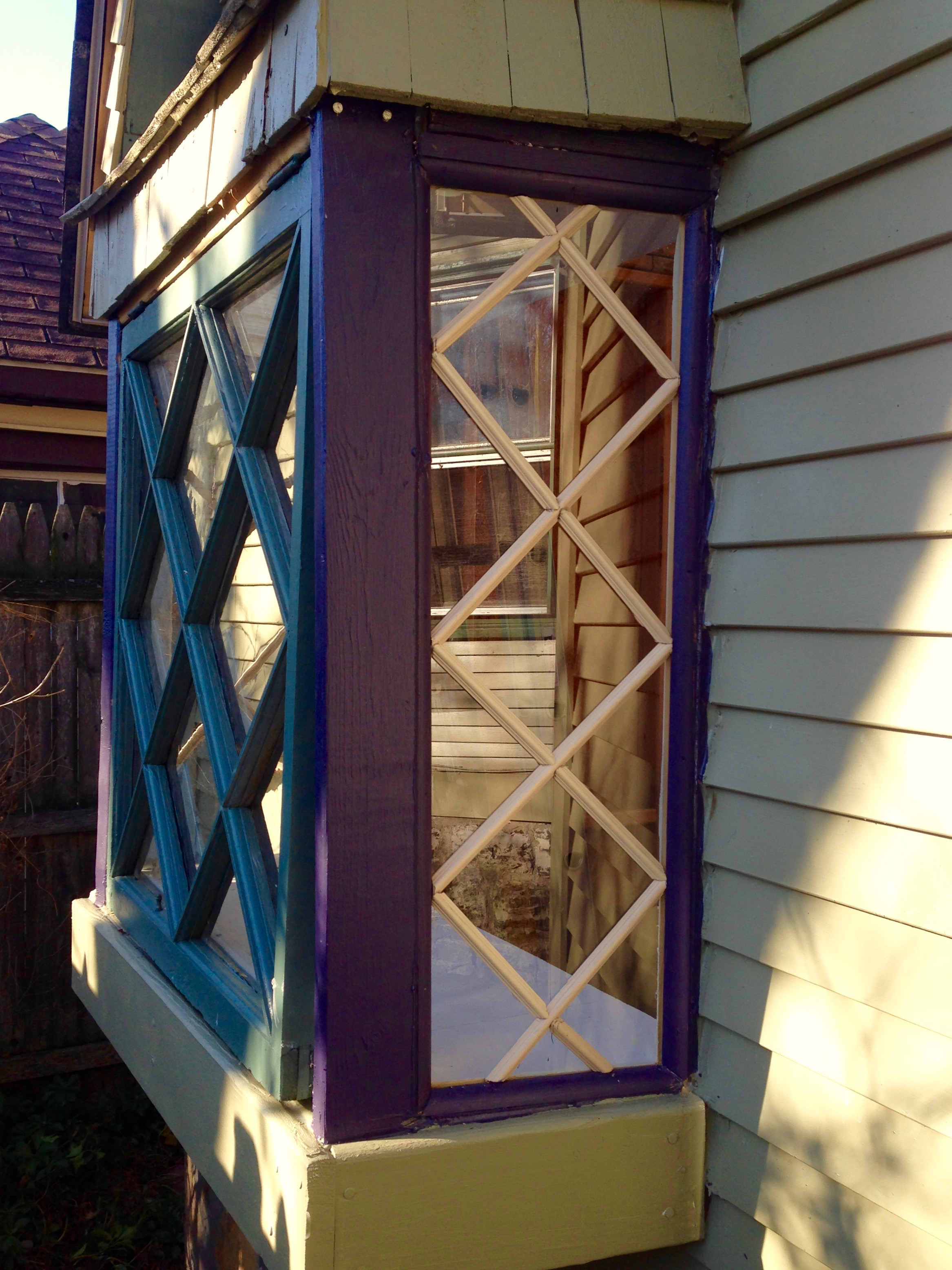sidelight, complete with diamond-shaped mullions, on a bumped-out bay window for the shed.