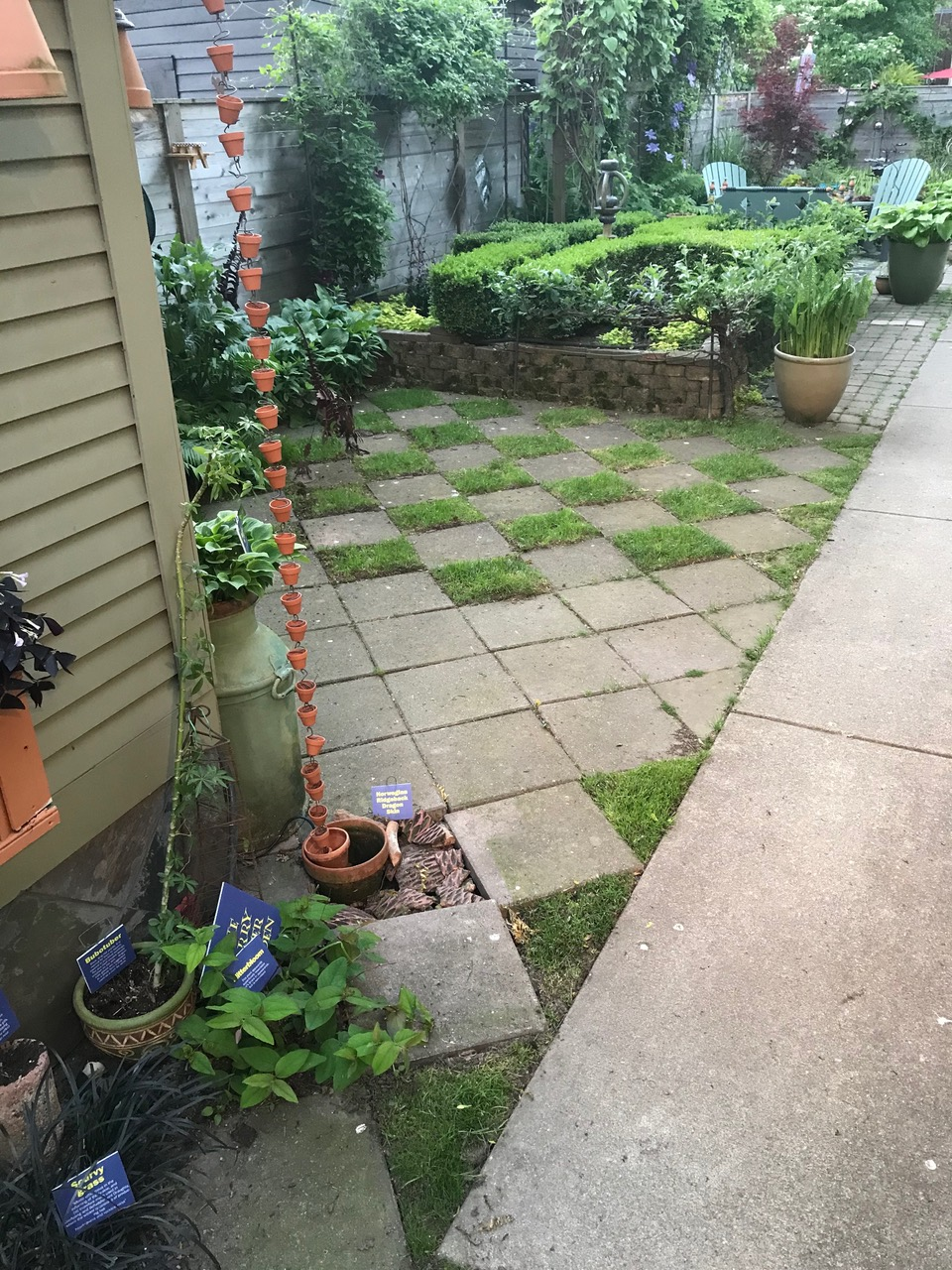 checkerboard of grass and pavers